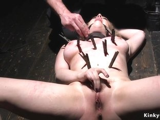 Busty slave zippered and fucked with toy
