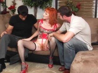 Redhead Sasha Brand fucked by two hard men