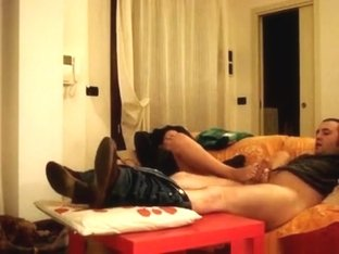 Nerdy italian girl gives her bf a footjob on the sofa