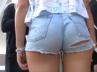 Two blonde girls wearing tight jeans shorts