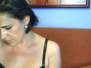 Hot milf wife strips and masturbates on webcam