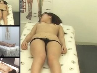 Lovely Asian babe gets fingered in voyeur massage video
