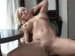 Older UK pornstar Jane Bond boffs her slit with a overweight sex toy
