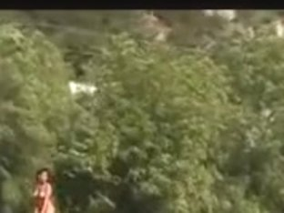 Dark woman booty in nature's garb in public