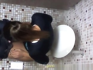 Hidden camera in toilet ceiling catches woman pissing