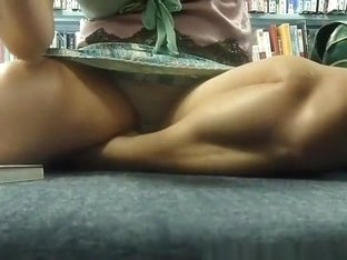 Woman seated in the library floor upskirted