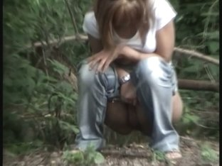 Girl pissing outdoor gets her pussy voyeured in close up