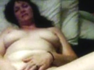 Mature lady masturbating with dildo