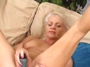 Stunning granny having fun with a dildo