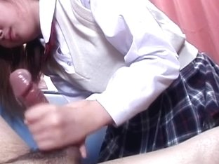 Japanese schoolgirl mouth lubing and stroking a stiff boner