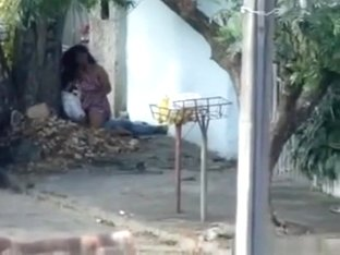 Voyeur tapes a horny latin couple having sex on the pavement
