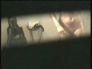 Busty brunette filmed naked by a window voyeur