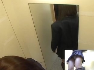 Upskirt view of an Asian girl changing in dressing room