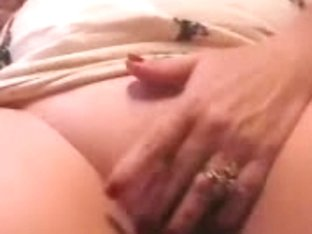 She touches her pussy until it becomes fully wet