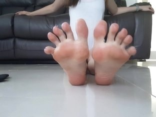 Angel Points Her Toes in Flip Flops