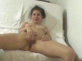 Amateur Zuzinka fucks her pussy with glass dildo