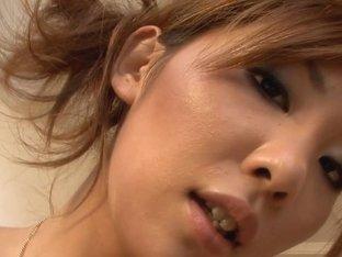 Erena Kurosawa gives fine gandjob to dude