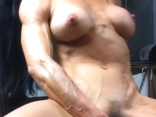 Body builder toys her plump fur pie
