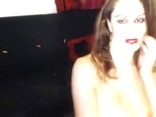 Bosomy webcam milf fingers her throbbing twat on a sofa