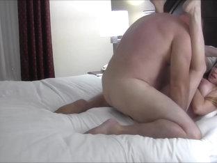 HUSBAND &  WIFE IN HOTEL ROOM