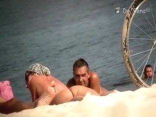 Voyeur at nudist beach films nude men and woman