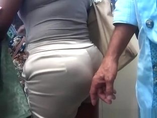 Dude gropes big ass woman in tight shorts