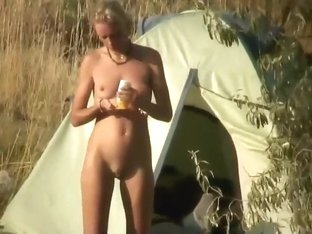 Nudist camper rubs oil all over herself