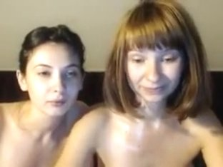 Two girls get oiled up and fondle themselves