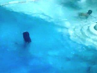 Horny bikini downblouse of busty Latina in the pool