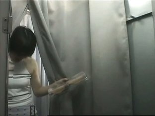 Asian girl stripping for a hidden camera in a changing room