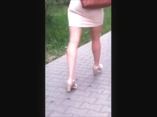 Girl with sexy legs and ass in transparent dress