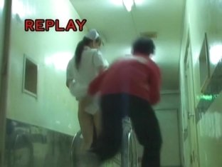 Man is pulling up nurse dress and pinching her booty