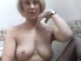 Milf fingering pussy in stockings