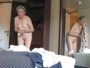 Hidden camera shoots this elder lady putting on clothes