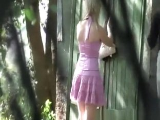 2 women peeing outdoors