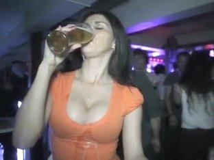 Club babe chugs a beer in slow motion