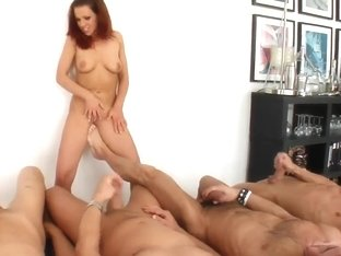 Slutty brunette kitty Lia is deeply sucking huge and hard three dicks at the same time and moaning.