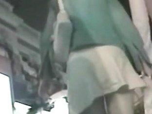 Slutty woman in a white skirt caught on a hidden cam