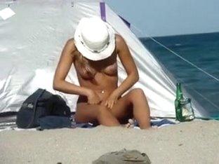 Blonde cutie gets caught on a hidden camera on a nude beach