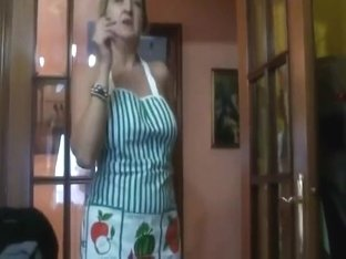 Ugly mature lady smoking naked in the kitchen and talking a lot
