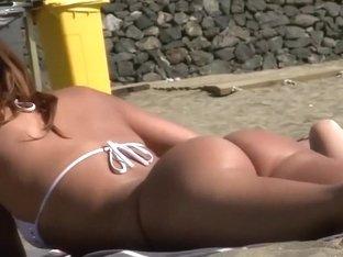 Gorgeous close look on a beach girl's ass