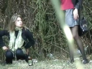 Pretty woman caught pissing outside