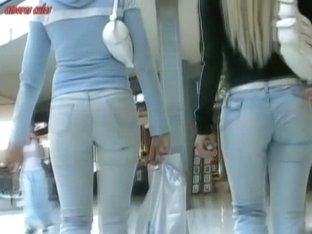 Big butt blonde and brunette caught by street booty voyeur