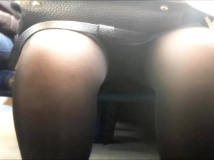 Sunlight across thighs and cleft encased in black tights