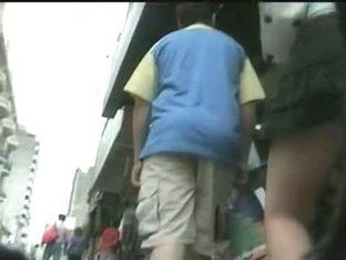Enticing ass in a short skirt on an upskirt spy cam video