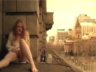 Ginger girl masturbates in public outside her apartment
