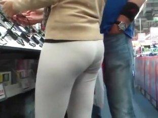 Female shopaholic in skintight pants