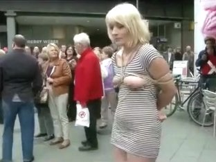 Submissive woman bound and exposed in public