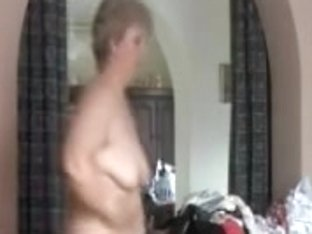 Granny showed her fat body before putting on clothes