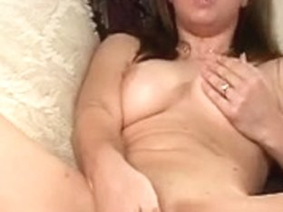 Dark Brown removes hot underware and masturbates on a daybed